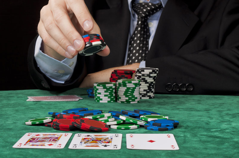 Businessman Playing Poker
