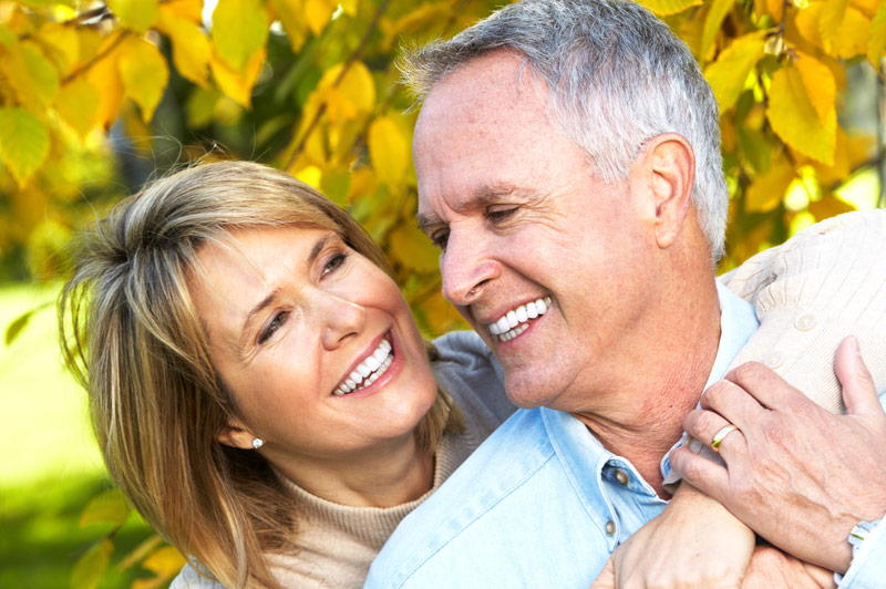 Elderly Couple Embracing Outdoors