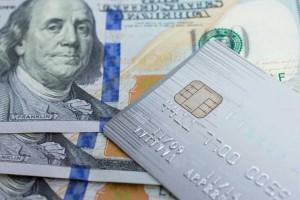 credit card and $100 bills