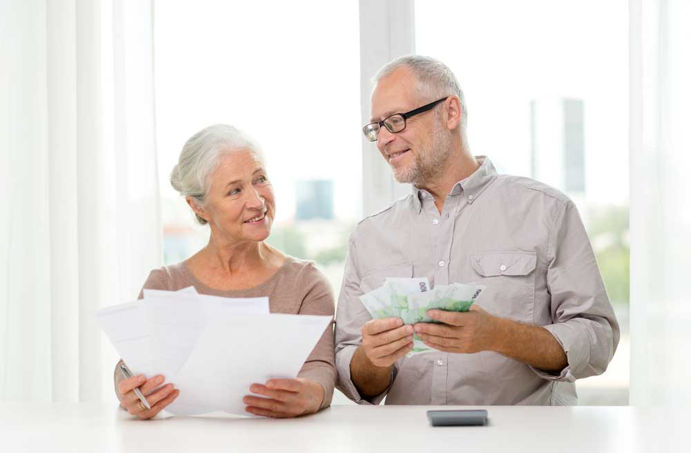 Elderly Couple Looking at Tax Deductions