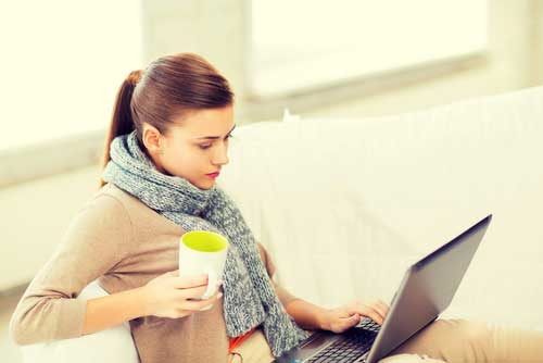 Woman Looking at Tax Information On Laptop