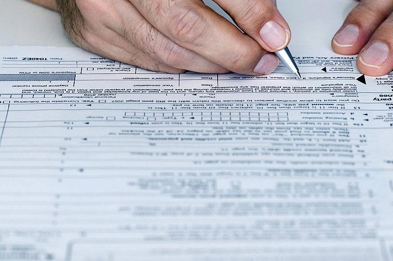 Man Filing Income Tax Return