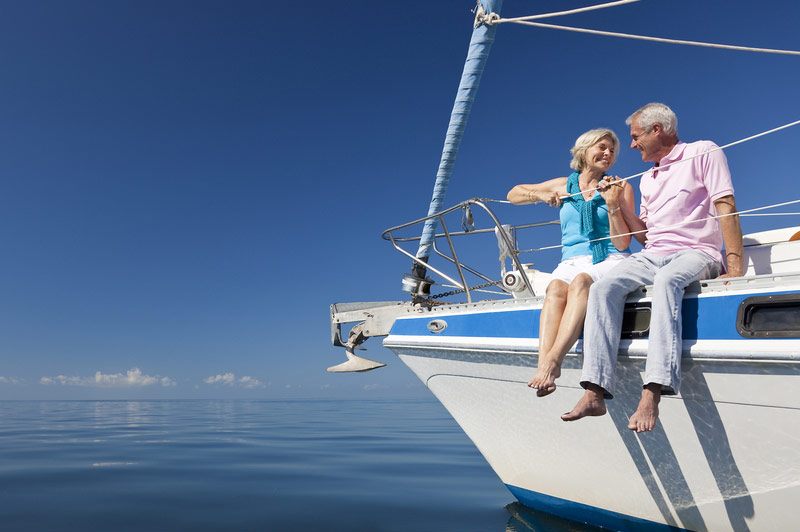 Retired Couple Sitting On Sailboat
